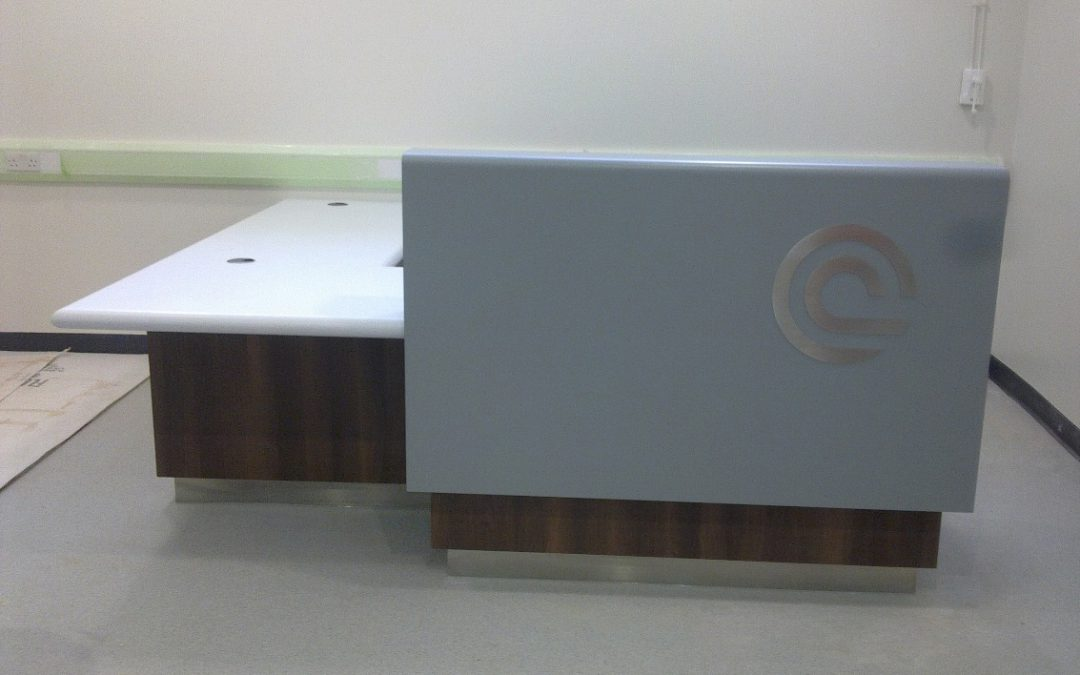 Hospital – Reception desk with laminated timber base and Corian cladding